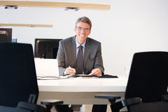Financial Advisor Sitting At His Desk Stock Photos