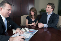 Financial advisor working with concerned Clients Stock Photo