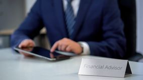 Financial advisor working on tablet pc, budget planning application, investment. Stock photo royalty free stock images