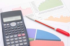Financial analysis. Photograph of a calculator, financial figures and pen Stock Photos