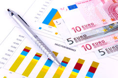Financial Analysis with charts and currency Royalty Free Stock Image