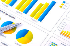 Financial Analysis  with charts and metallic pen Royalty Free Stock Image