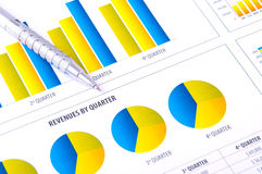 Financial Analysis  with charts and metallic pen Royalty Free Stock Photos