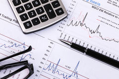Financial analysis concept. Inancial concept including statistics, graphs, charts Royalty Free Stock Images
