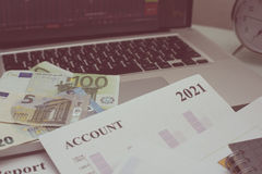 Financial analysis document and part of money and coins stacked Stock Images