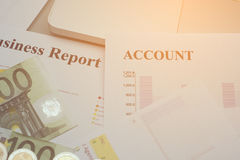 Financial analysis document and part of money and coins stacked Royalty Free Stock Photos