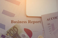 Financial analysis document and part of money and coins stacked Royalty Free Stock Images