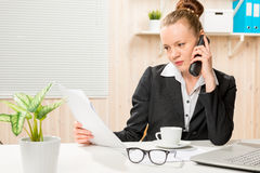 Financial analyst on the phone with the director. Of the company stock photo