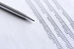 Financial  analyze. Pen on the financial report Royalty Free Stock Photo