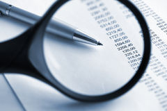 Financial  analyze with magnifying glass. Close up Stock Images