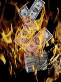 Financial apocalypse crisis. Financial crisis.Burning american money. Apocalyptic view of the financial future of the world Royalty Free Stock Images