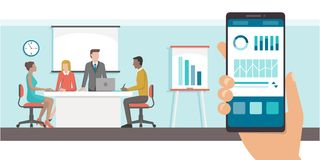 Financial app and business meeting. Finance and administration app with charts on a smartphone and business meeting in the office on the background Royalty Free Stock Photos