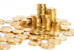Financial assets. Stack and a scattering of coins on a white background Stock Photos