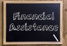 Financial Assistance. New chalkboard with 3D outlined text - on wood Stock Photos