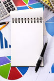 Financial background with blank notepad Royalty Free Stock Images