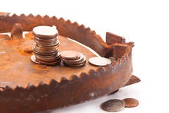 Financial bait. Coins in a trap on a white background Royalty Free Stock Photography