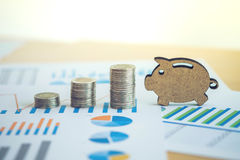 Financial banking stock spreadsheet with stack coin and piggy on Royalty Free Stock Image