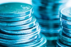 Financial blue background with coins macro closeup. Royalty Free Stock Image