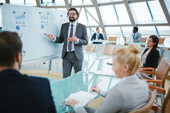 Financial briefing. Business leader presenting new strategy to his team royalty free stock photos