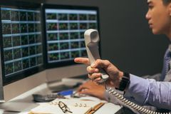 Financial broker with telephone receiver Royalty Free Stock Photography