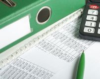 Financial and budget concept. Calculator, pen, accounting books and financial document on office table