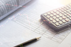 Financial budget stock market investment. Document of financial budget stock market investment chart and calculator on the desk Stock Image