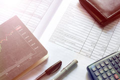 Financial budget stock market investment. Document of financial budget stock market investment chart and calculator on the desk Royalty Free Stock Photo