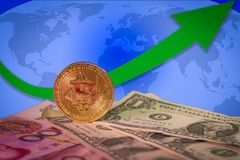 Financial bull market rising concept with golden bitcoin above dollar and yuan bills stock image