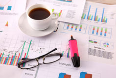 Financial and business color charts and graphs on the table Royalty Free Stock Image