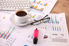 Financial and business color charts and graphs on the table Stock Image