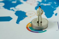 Financial business concept as miniature businessman standing on Royalty Free Stock Photo