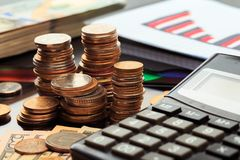 Financial business concept combination with coins, money, calculator and pen. Image stock photo