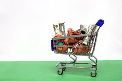 Financial Business Concept - Shopping Cart with Money Royalty Free Stock Photos