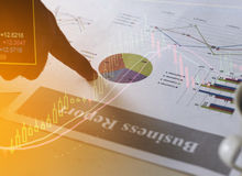 Financial business report paper charts and stock market concept Stock Photography