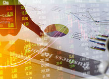 Financial business report paper charts and stock market investment graphs with hand Stock Image