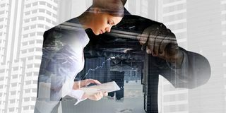 Financial business services. Mixed media. Double exposure of businessman draw on screen and modern city landscape. Mixed media Royalty Free Stock Photos
