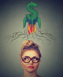 Financial business success concept. Thouhtful woman looking up. Financial business success concept. Thoughtful young woman looking up Royalty Free Stock Image