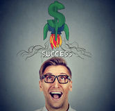 Financial business success. Surprised man looking up. Financial business success concept. Surprised happy young man looking up Royalty Free Stock Images