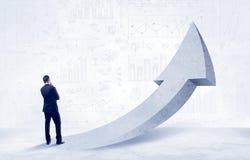 Financial businessman with arrow concept Stock Photos