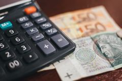 Financial calculations with coins, banknotes. And credit cards Royalty Free Stock Images