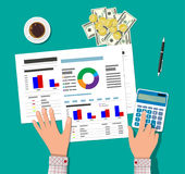 Financial calculations. Working process. Financial calculations, working process. Businessman hands, calculator, financial reports, money, coins, pen and coffee Stock Image