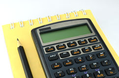 Financial calculator with notebook and pencil Royalty Free Stock Photography