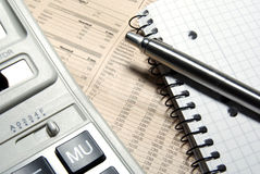 Financial calculator, steel pen and notebook. Stock Image