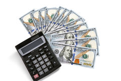 Financial calculator and US money Royalty Free Stock Photo