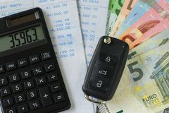 Financial car installment concept as car key, calculator and bil Stock Photos