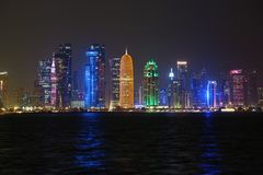 Financial centre in Doha city at night, Qatar. QATAR, DOHA, MARCH 20, 2018: Night financial centre in Doha - capital and most populous city in Qatar. View on royalty free stock photo