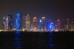 Financial centre in Doha city at night, Qatar. QATAR, DOHA, MARCH 20, 2018: Night financial centre in Doha - capital and most populous city in Qatar. View on stock photos