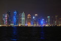 Financial centre in Doha city at night, Qatar. QATAR, DOHA, MARCH 20, 2018: Night financial centre in Doha - capital and most populous city in Qatar. View on stock image