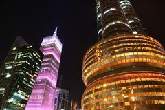 Financial centre in Doha at night, Qatar. QATAR, DOHA, MARCH 20, 2018: Financial centre, NOC and pink Al-Asmakh Towers in Doha at night - capital and most stock photography