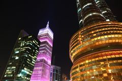Financial centre in Doha at night, Qatar. QATAR, DOHA, MARCH 20, 2018: Financial centre, NOC and pink Al-Asmakh Towers in Doha at night - capital and most stock images